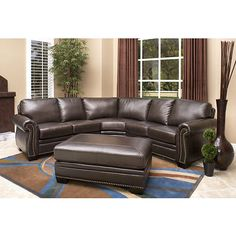 Enjoy Luxurious Italian Leather For Years To Come With This Beautiful Rolled Arm Sectional And