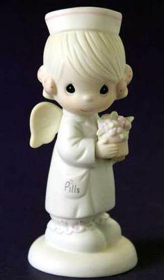 Precious Moments Angel of Mercy NURSE Porcelain Figurine