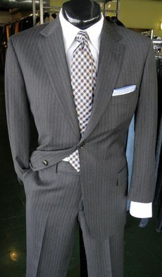Suit by Hugo Boss(42R) Shirt by Robert Graham(L) Tie by FLIP Pocket Square