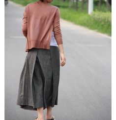 /a grey skirt ;looks so feminine with a pink sweater