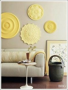 Purchase ceiling medallions from the home improvement or thrift store, and paint them all the same color - cheap wall decor