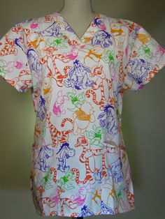#caringplus scrub top -Winnie the Pooh & Friends- CaringPlus scrubs and uniforms - workwear clothing for nurses, caregivers and other healthcare professionals.  Perfect apparel for doctor, dental and optician offices, nursing homes, rehab centers, vet clinics, animal hospitals, or medical labs.