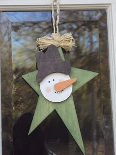 Wooden Snowman Star Wall Hanging Holiday Decoration. $19.00, via Etsy.