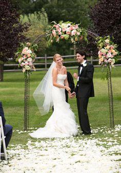 pink floral arbor at elegant garden wedding  Love the arbor @Katie Hyska