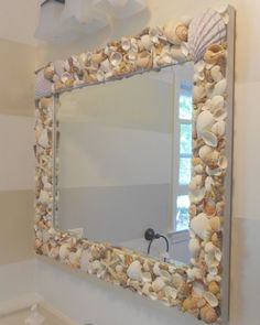 DIY Shell Mirror! All you need is some shells of different sizes, a mirror, some newspaper and glue!