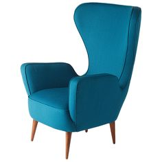 Wingback Armchair - Contemporary Collection   From a unique collection of antique and modern wingback chairs at https://www.1stdibs.com/furniture/seating/wingback-chairs/