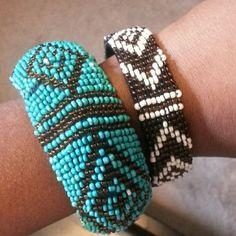 Bangle Set Tribal print bangle set. One is blue and brown and one is brown and white. The blue one has a few unnoticeable loose strings. Jewelry Bracelets