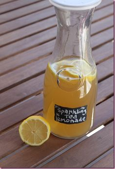 Sparking Tea Lemonade | -6-8 bags, tea (ginger or green),3 C hot water, sugar to taste, 12 oz sparkling lemon-flavored water, 3 lemons: 2 juiced, 1 sliced