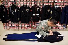 """Michael Deynes ~ prepares the uniforms and dresses American soldiers for burial. """"It's more than an honor its a blessing to dress that soldier for the last time"""" In this picture he prepares the uniform of an Army pilot killed in Afghanistan. Fallen Heroes, Fallen Soldiers, Staff Sergeant, Support Our Troops, Military Life, Military Quotes, Military Honors, Military Families, Real Hero"""