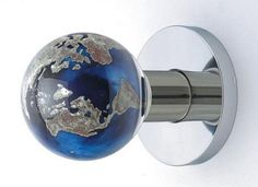 This glass globe door knob would be the perfect addition to a world travelers eclectic decor.  travel. home decor. unique door knobs.