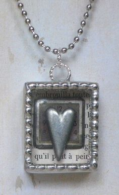 Soldered Shadowbox Pendant Necklace with Vintage Watch Face, 3-D Pewter Heart, and Original Collaged Images. $40.00, via Etsy.