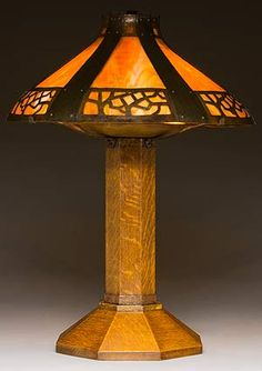 Electric lamp No. 625  designed c. 1909  Oak, copper, glass  Crab Tree Farm. With its stout, faceted wooden base and metal strapwork shade (a fabric one was also offered), this lamp is one of Stickley's more successful table lamp designs.