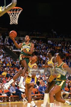Dale Ellis #3 of the Seattle Supersonics takes the ball to the basket against Byron Scott #4 of the Los Angeles Lakers during a game in the 1987-1988 NBA season at the Great Western Forum in Los Angeles, California.