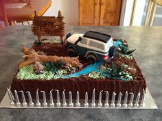 4wd Nissan Patrol 21st Cake.. chocolate mud cake transformed into bush 4wd track ... apparently the lad spoke for so long with the candles burning the ganache melted and they had a mud slide and flowing river