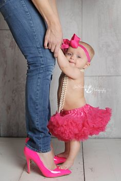 cute baby girl photo idea - baby in headband, tutu, and pearls while standing on mommy's feet in same colored heels.