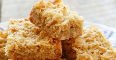 Chewy coconut filling layered onto a buttery shortbread crust; this recipe is so simple to make I have been making it since I was a chil...