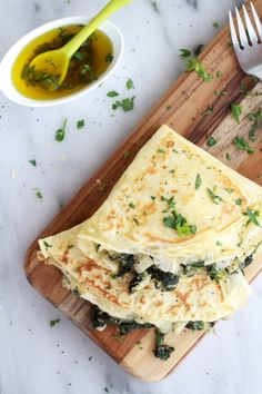 Yummy food crepes, not sweet. Spinach, artichoke, brie.