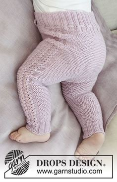 The set consists of: Hat for baby with garter stitch, wave pattern and earflaps. Wrap-around jacket and trousers with garter stitch and lace pattern. Sizes premature – 4 years. The set is knitted in DROPS Baby Merino. Free pattern by DROPS Design.
