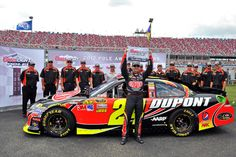 Jeff Gordon celebrates with his No. 24 DuPont team in Victory Lane at Talladega Superspeedway after winning the pole on May 5.
