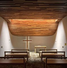The photograph shows the interior of the Prayer Chapel designed by Gensler Modernizes. I really like the simplicty, minimalism and warmness of this space. As it is very small space it allows to people to feel comfortable and safe, so they can concentrate on their prayers.
