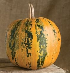 Check out Kakai! This pumpkin is very ornamental but can be baked up nicely like spaghetti squash!