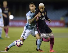 Barcelona's Brazilian forward Neymar vies with Celta Vigo's defender Hugo Mallo during the Spanish league football match RC Celta de Vigo vs FC...