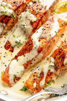 To Cook Salmon In A Mouthwatering Garlic Butter Cream Sauce! Deliciously seasoned, pan seared salmon filets -- juicy and tender on the inside with perfect crisp edges. Smothered in a gorgeous garlic butter sauce with Salmon Recipe Pan, Seared Salmon Recipes, Pan Seared Salmon, Baked Salmon, Simple Salmon Recipe, Easy Salmon Recipes, Simple Sauce For Salmon, Recipes For Salmon Filets, Salmon Belly Recipes