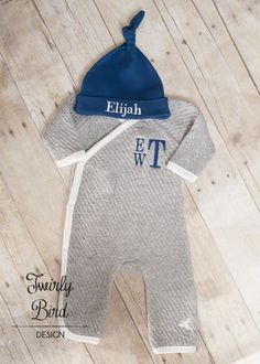 Going Home Outfit Boy - for Newborns and up to 12 months sizing.  Your precious little one can snuggle up in this Organic Cotton Footless Coverall and Hat. The Kimono Style Wrap with Snap Button Closures makes it so easy to wrap your newborn up in softness and the Quilted Cotton will keep your baby warm and snuggly! Makes a perfect baby shower gift! Contact me for other customization options…