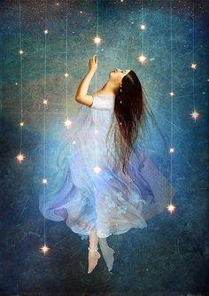 chica tocando las estrellas