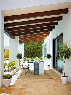 Modern Spanish-inspired covered patio.