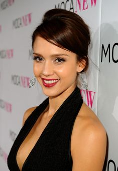 Jessica Alba Red Lipstick - Jessica always looks classy on the red carpet. Adding the perfect dash of color, the actress paired her fluttering lashes with berry red lipstick.