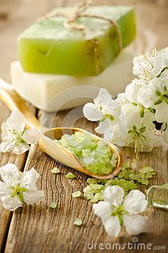 Vintage spa scene with green salt, spring flowers and bar of soap
