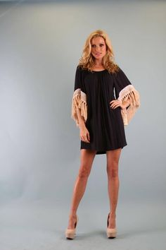 How fun is this dress with fringe??  Pair it with some cowboy boots & have a blast!!