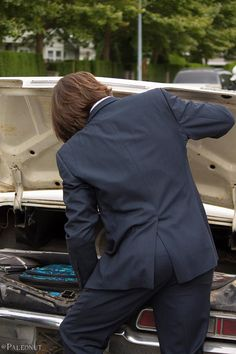 Jared signing a fan's Impala :)..... Pamela was right. you could bounce a nickel off that ass. Lmao