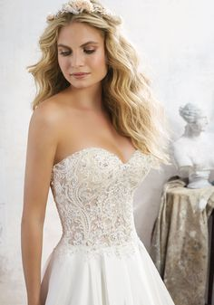 Morilee by Madeline Gardner 'Mara' 8114 | Crystal Beaded Embroidery Accents this Corset Style Sweetheart Bodice. Duchess Satin Skirt. Crystal Button Detail. Colors Available: White, Ivory, Ivory/Nude. Shown in Ivory/Nude.