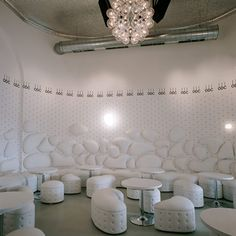 """Vienna architect Denis Kosutic has completed the interior of a restaurant in Vienna, Austria, inspired by """"Queen Elizabeth, the rapper 50 Cent and a girl from Tyrol""""."""