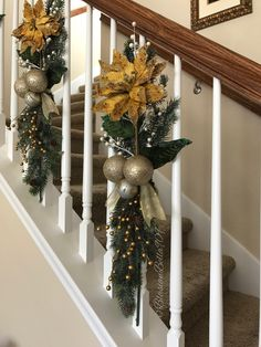 handcrafted greenery and floral swags decorated on the staircase banisters which free up the rails to use christmas holiday home stairwell staircase