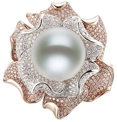 Two-Tone Pearl Flower Ring A 13-14mm white South Sea pearl nests atop two layers of flower petals, accented with pave diamonds for this ring.