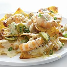 Shrimp and crab nachos :: Made these and added some corn as well -- the sweetness complemented the recipe just perfectly! It does taste a bit like it's missing a flavour... I think adding sauteed/caramelized onions would do the trick.