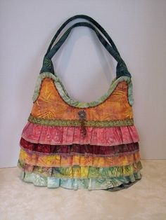 Best representation descriptions: Handmade Fabric Purses and Bags Related searches: Handmade Bags and Purses,Handmade Purse Ideas,Handmade . Handmade Purses, Handmade Handbags, Fabric Purses, Fabric Bags, Ruffles Bag, Ruffle Skirt, Boho Bags, Bohemian Bag, Clutch