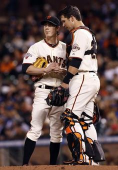 Tim Lincecum talks with catcher Buster Posey during his seven-inning outing against the Dodgers. Photo: George Nikitin, Associated Press
