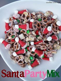 Bugle Santa hats (bugles dipped in red candy melts, dipped on the ends into white spinkles, topped with a mini marshmallow), mini pretzels, craisins, dry roasted peanuts, rice chex, holiday m's, drizzled with white chocolate