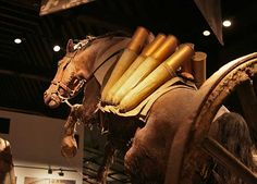 'In Flanders Fields' Cloth Hall Museum, Ypres. A horse of the Great War is shown pulling an ammunition carriage.
