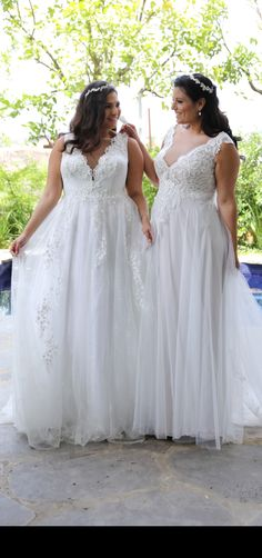 Stunning plus size wedding gowns from Studio Levana. Tracie and Julia