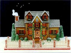 A beautifully designed and decorated Gingerbread House by Joan Grunzweig. Visit www.ultimategingerbread.com for patterns, photo's, recipes and contests.