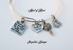 "Lovely ""Maid of Honor"" bracelet.  This fashionable expandable bangle bracelet is a Beautiful Gift for your Maid of Honor.  This expandable bangle bracelet is made from lead free zinc alloy.   Bracelet charms included are a silver flower bouquet, a ..."