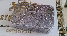 Embossed tin covered Altoid box perhaps?