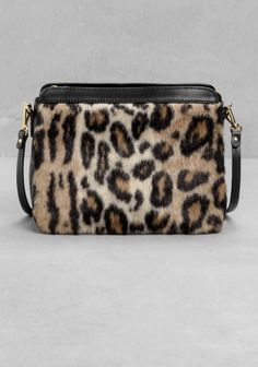 Eye-catching and ultra-chic, this faux fur bag has removable shoulder straps.