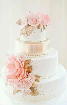 Beautiful four-tiered pink and gold wedding cake.