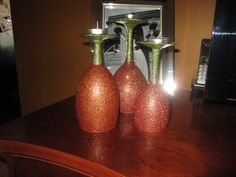 Glittered pumpkin wine glass candle holders.